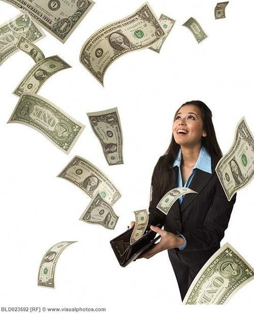 Studio_shot_of_woman_with_money_flying_out_of_her_BLD023592